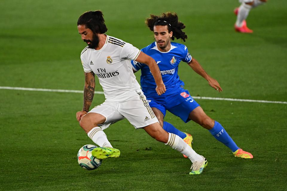 Getafe's Spanish defender Marc Cucurella (R) challenges Real Madrid's Spanish midfielder Isco during the Spanish league football match Real Madrid CF against Getafe CF at the Alfredo di Stefano stadium in Valdebebas, on the outskirts of Madrid, on July 2, 2020. (Photo by GABRIEL BOUYS / AFP) (Photo by GABRIEL BOUYS/AFP via Getty Images)