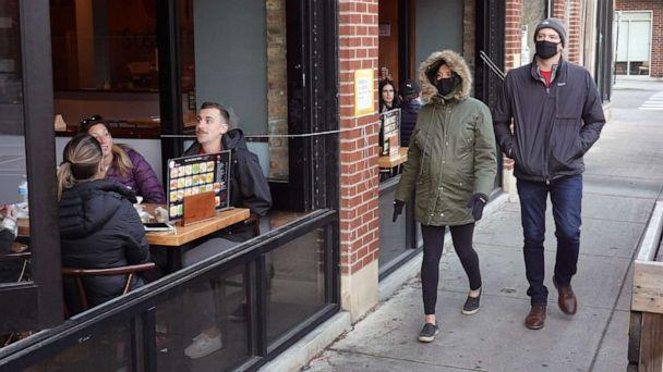 PHOTO: Despite temperatures in the mid-forties, customers continue to patronize restaurants and bars in the Wicker Park neighborhood on Nov. 11, 2020, in Chicago. (Scott Olson/Getty Images)