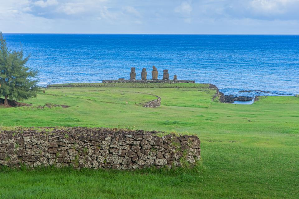 View of Moais -- stone statues of the Rapa Nui culture -- in Easter Island, 3700 km off the Chilean coast in the Pacific Ocean, on March 31, 2020. - Local authorities in Easter Island believe that the spread of the COVID-19 coronavirus is almost contained, but they fear the consequences of the abrupt stoppage of tourism, the economic engine of this volcanic island in Polynesia. (Photo by MIGUEL CARRASCO / AFP) (Photo by MIGUEL CARRASCO/AFP via Getty Images)