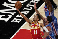 Atlanta Hawks' Trae Young (11) shoots next to Brooklyn Nets' Joe Harris, lower right, during the first half of an NBA basketball game Wednesday, Jan. 27, 2021, in Atlanta. (AP Photo/Brynn Anderson)