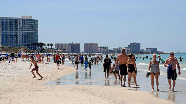 PHOTO: CLEARWATER, FL - MARCH 18: People gather on Clearwater Beach during spring break despite world health officials' warnings to avoid large groups on March 18, 2020 in Clearwater, Florida. (Mike Ehrmann/Getty Images)