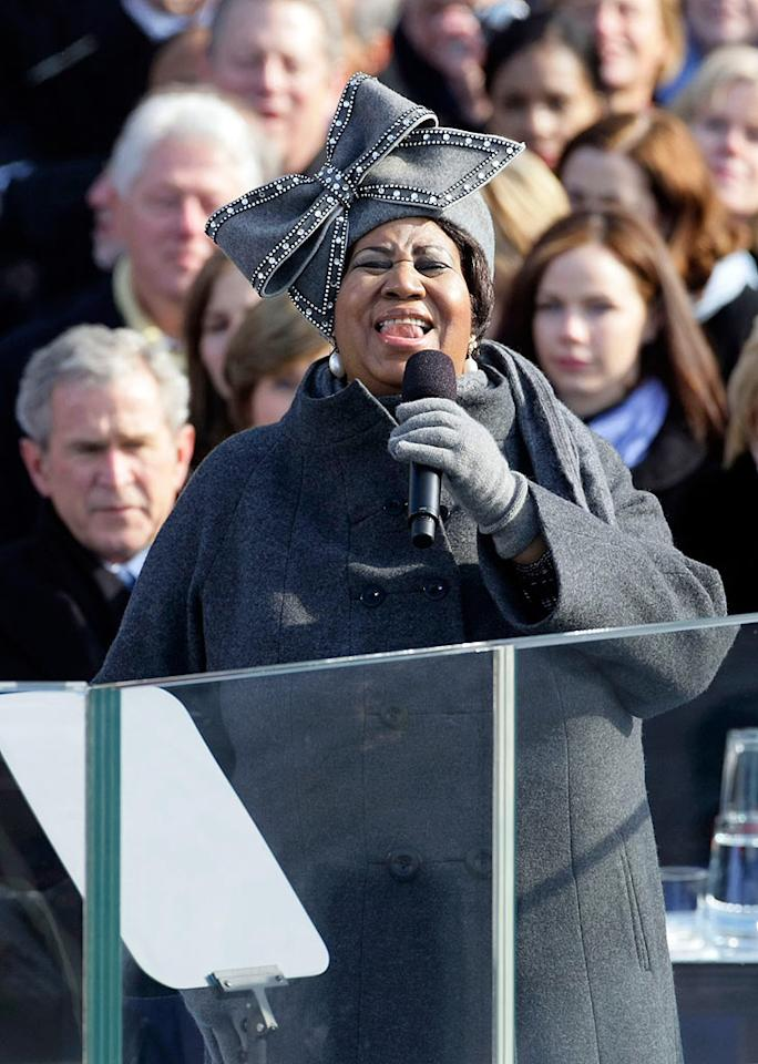 """No one could miss Aretha Franklin's big voice -- or her big bowed hat -- during the presidential inauguration ceremony. Calls flooded Luke Song's hat store for the gray felt design. The Korean-American milliner is offering satin ribbon versions for $179. Alex Wong/<a href=""""http://www.gettyimages.com/"""" target=""""new"""">GettyImages.com</a> - January 21, 2009"""
