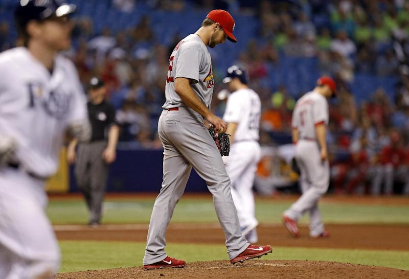 St. Louis Cardinals starting pitcher Michael Wacha reacts after walking Tampa Bay Rays' Ryan Hanigan during the fourth inning of a baseball game Wednesday, June 11, 2014, in St. Petersburg, Fla. (AP Photo/Mike Carlson)