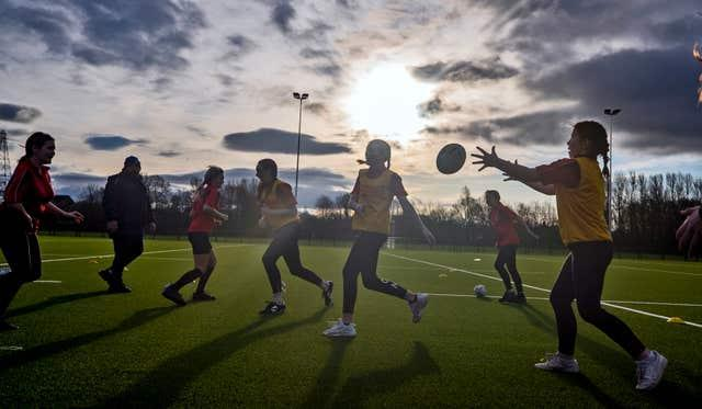 Children play rugby on the new 3G pitch at Victoria Park Rugby League Football Club, Warrington