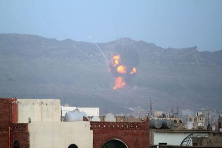 An explosion is seen at the Noqum Mountain after it was hit by an air strike in Yemen's capital Sanaa May 19, 2015. REUTERS/Mohamed al-Sayaghi