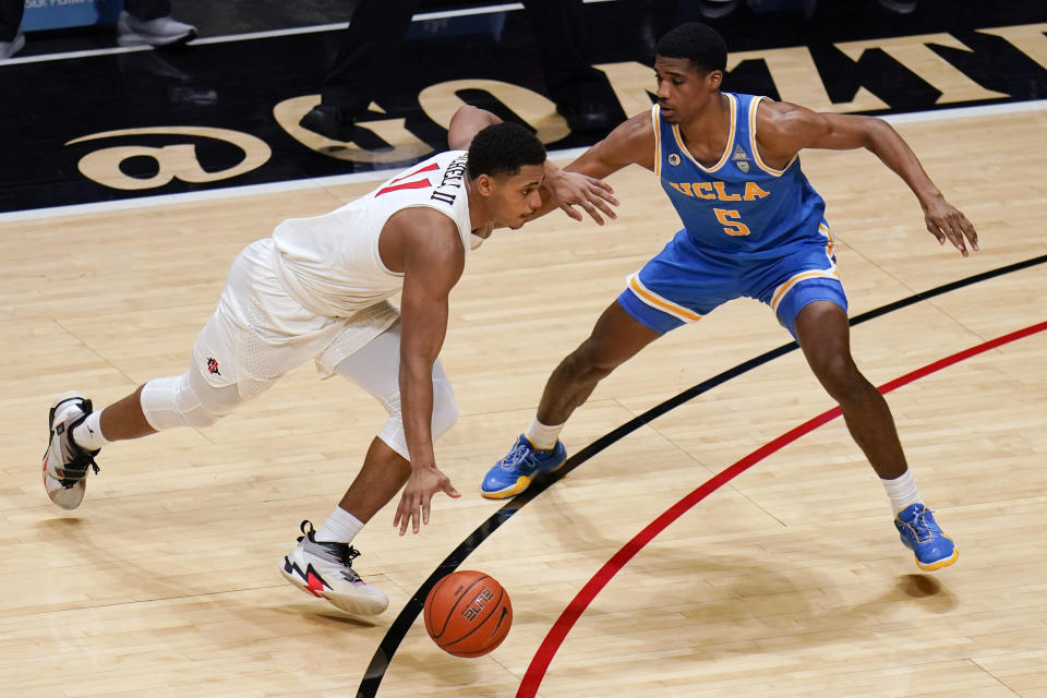 San Diego State forward Matt Mitchell, right, drives to the basket as UCLA guard Chris Smith (5) defends during the first half of an NCAA college basketball game Wednesday, Nov. 25, 2020, in San Diego. (AP Photo/Gregory Bull)