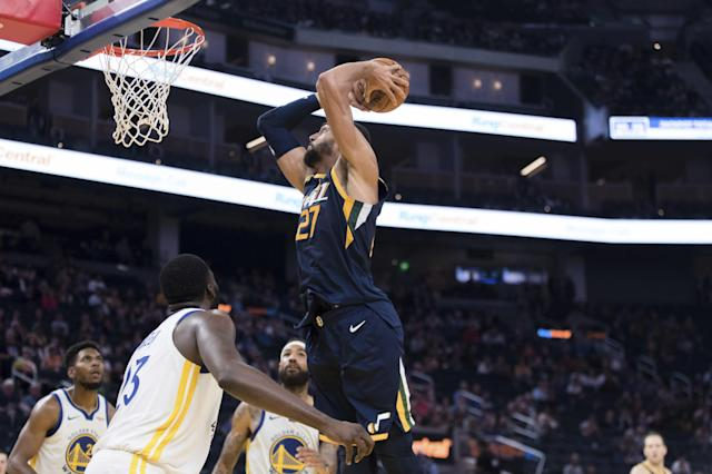 Utah Jazz center Rudy Gobert (27) shoots against the Golden State Warriors in the second half of an NBA basketball game in San Francisco, Monday, Nov. 11, 2019. The Jazz won 122-108. (AP Photo/John Hefti)