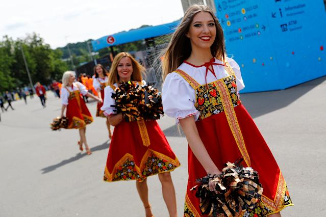 Soccer Football - World Cup - Group A - Russia vs Saudi Arabia - Luzhniki Stadium, Moscow, Russia - June 14, 2018 Cheerleaders in traditional dresses outside the stadium before the match REUTERS/Kai Pfaffenbach