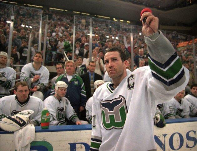 "Hartford Whalers captain Kevin Dineen waves to the fans Sunday, April 13, 1997, after he briefly addressed them at the end of the Whalers final game in Hartford, Conn. The Whalers defeated the <a class=""link rapid-noclick-resp"" href=""/nhl/teams/tam/"" data-ylk=""slk:Tampa Bay Lightning"">Tampa Bay Lightning</a> 2-1 to end their season and their stay in Hartford. (AP Photo/Richard Mei)"