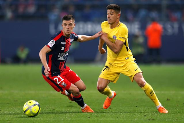 Soccer Football - Ligue 1 - Caen vs Paris St Germain - Stade Michel d'Ornano, Caen, France - May 19, 2018 Caen's Frederic Guilbert in action with Paris Saint-Germain's Yuri Berchiche REUTERS/Pascal Rossignol