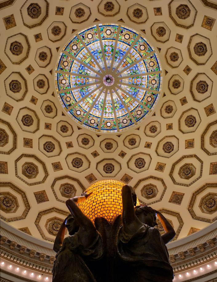 "<h1 class=""title"">Judson Studios. LA County Natural History Museum.</h1> <div class=""caption""> Rotunda of the Natural History Museum of Los Angeles. Judson created both the glass dome and the globe being held by Julia Bracken Wendt's <em>Three Muses,</em> 1914. </div> <cite class=""credit"">Photo: Alexander Vertikoff / Courtesy of Judson Studios</cite>"