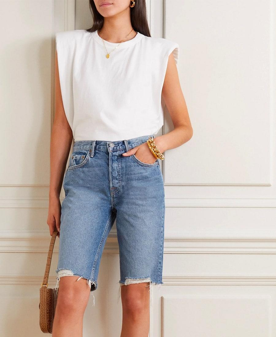 """If culottes and <a href=""""https://www.glamour.com/story/comfortable-jeans-quarantine?mbid=synd_yahoo_rss"""" rel=""""nofollow noopener"""" target=""""_blank"""" data-ylk=""""slk:high-waisted jeans"""" class=""""link rapid-noclick-resp"""">high-waisted jeans</a> had a baby, it would be these bermuda shorts. $180, Net-a-Porter. <a href=""""https://www.net-a-porter.com/en-us/shop/product/grlfrnd/beverly-distressed-denim-shorts/1232687"""" rel=""""nofollow noopener"""" target=""""_blank"""" data-ylk=""""slk:Get it now!"""" class=""""link rapid-noclick-resp"""">Get it now!</a>"""