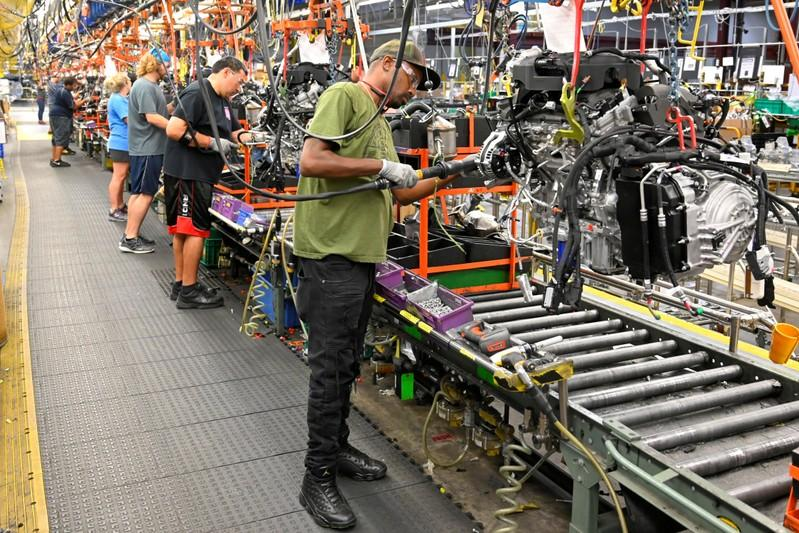 FILE PHOTO: Engines assembled as they make their way through the assembly line at the General Motors (GM) manufacturing plant in Spring Hill
