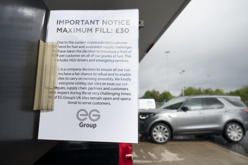 A sign indicating a limit on the amount of fuel sold out is seen at a petrol station in Manchester, Monday, Sept. 27, 2021. British Prime Minister Boris Johnson is said to be considering whether to call in the army to deliver fuel to petrol stations as pumps ran dry after days of panic buying. ( AP Photo/Jon Super)
