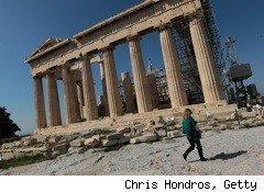 A woman walks by the pantheon in Greece where a new bailout plan may help the debt-plagued nation stabilize.