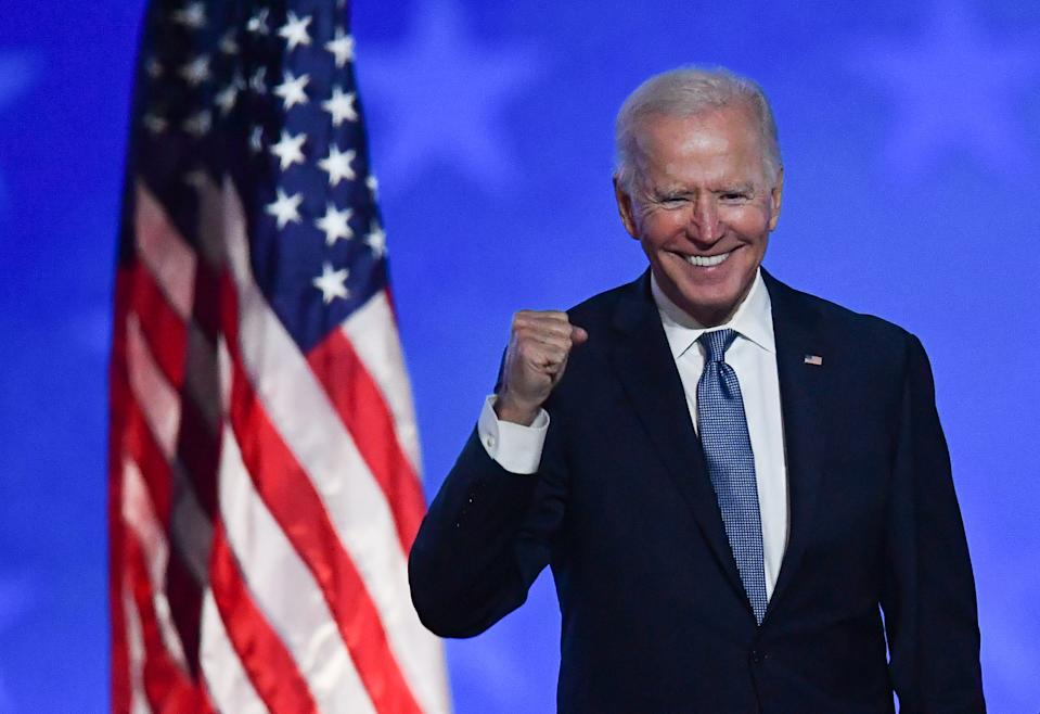Joe Biden, who has won the US election, gestures excitedly with a clenched fist.