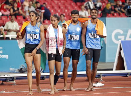Athletics - 2018 Asian Games - Mixed 4x400m Relay, Final - GBK Main Stadium, Jakarta, Indonesia - August 28, 2018 - Muhammed Anas Yahiya, Hima Das, Poovamma Raju Machettira and Arokiarajiv of India celebrate after the finish. REUTERS/Issei Kato