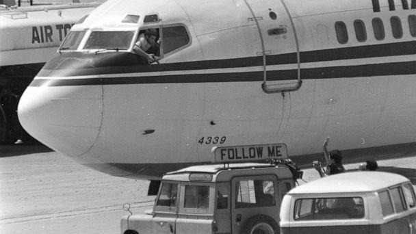 PHOTO: FILE - In this Wednesday, June 19, 1985 file photo, a hijacker points a weapon toward an ABC news media crew from the window of the cockpit of the Trans World Airlines jet at Beirut International Airport, Lebanon. (Herve Merliac/AP)