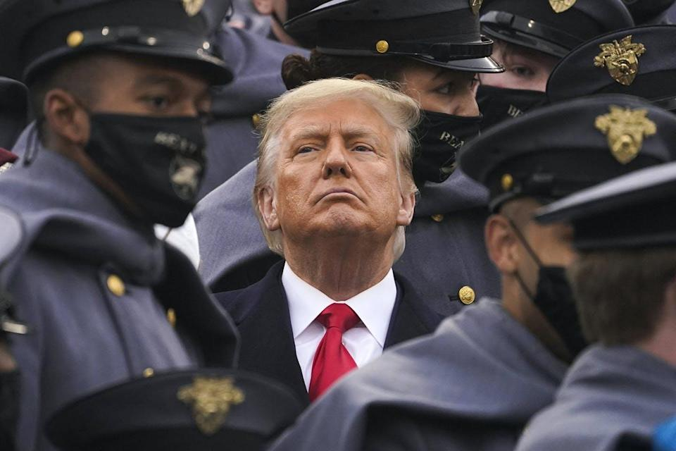 """<span class=""""caption"""">Surrounded by army cadets, U.S. President Donald Trump watches the first half of the 121st Army-Navy Football Game at the United States Military Academy in New York City on Dec. 12, 2020.</span> <span class=""""attribution""""><span class=""""source"""">(Shutterstock)</span></span>"""