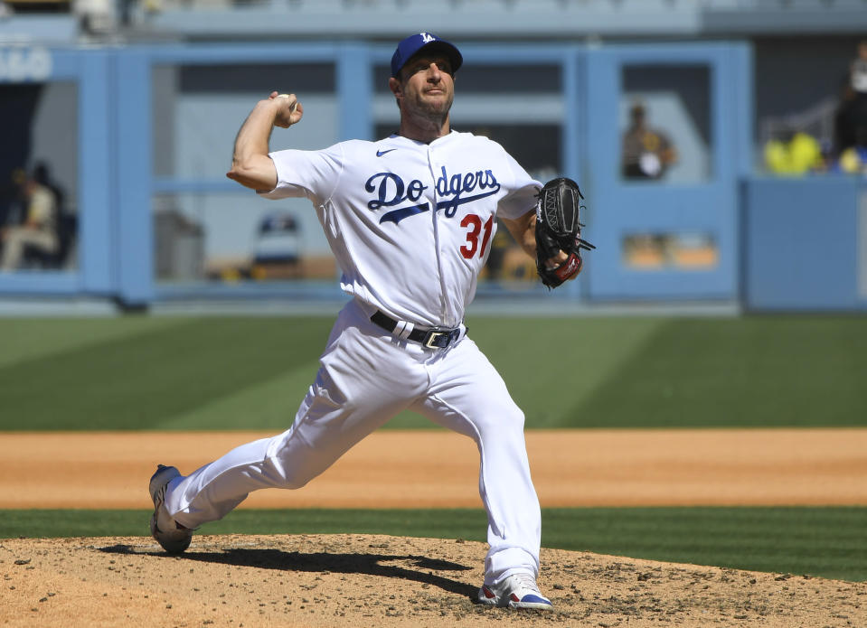 Los Angeles Dodgers Max Scherzer pitches his 3000th career strikeout with this throw against San Diego Padres first baseman Eric Hosmer in the fifth inning during in a baseball game Sunday, Sept. 12, 2021, in Los Angeles, Calif. (AP Photo/John McCoy)
