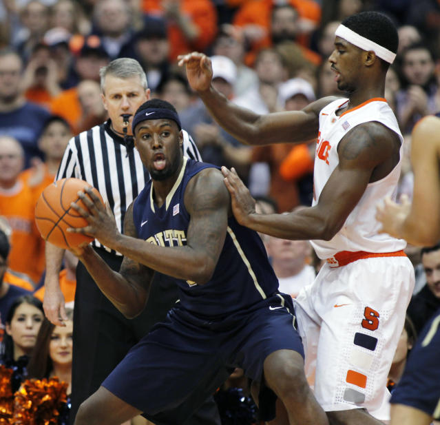 Pittsburgh's Jamel Artis, left, looks to pass the ball as Syracuse's C.J. Fair, right, defends during the second half of an NCAA college basketball game in Syracuse, N.Y., Saturday, Jan. 18, 2014. Syracuse won 59-54. (AP Photo/Nick Lisi)