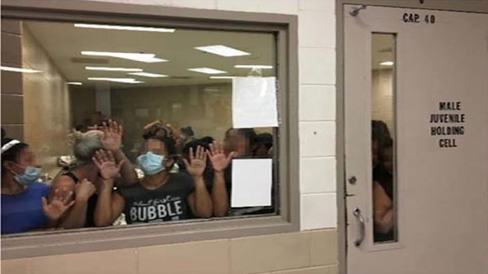 Some of a group of 51 adult females press against the window of a cell built to hold 40 male juveniles at Fort Brown Border Patrol station in a still image from video in Brownsville, Texas, U.S. on June 12, 2019 and released as part of a report by the Department of Homeland Security's Office of Inspector General on July 2, 2019. Picture pixelated at source. (Photo: Office of Inspector General/DHS/Handout via Reuters)