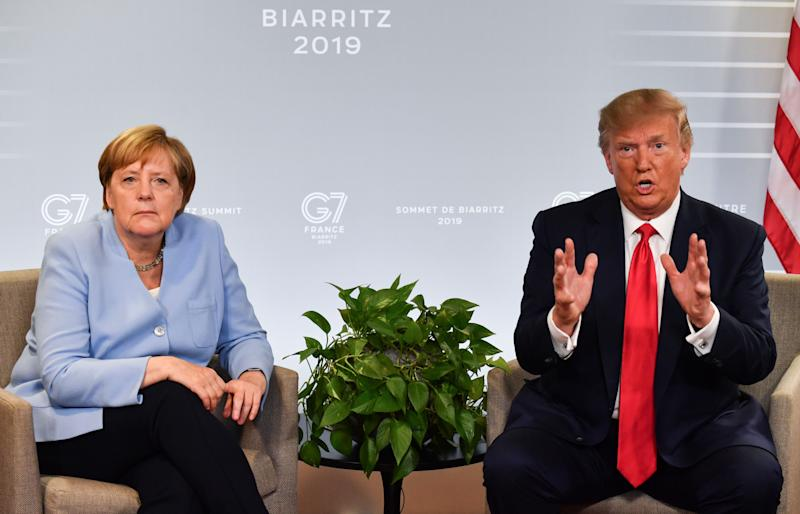 German Chancellor Angela Merkel (L) and US President Donald Trump