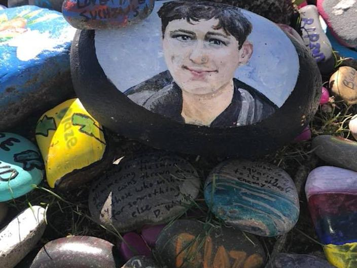 In Borrego Park, where Blaze Bernstein's light was extinguished, people from around the world leave stones in his memory. / Credit: Bernstein family