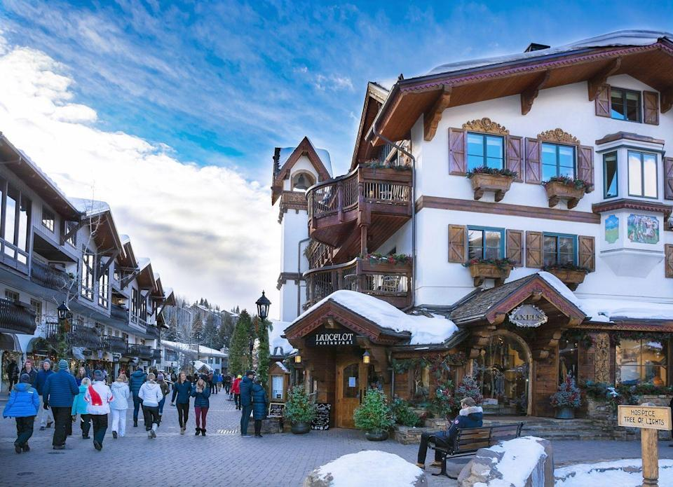 """<p>Vail, Colorado, is one of the most gorgeous winter escapes. The town's charming architecture and cobblestone streets look like they were ripped out of a fairytale and placed at the foot of the Rocky Mountains. Every year, the Christmas celebrations begin with <a href=""""https://gcpvail.com/blog/vail-co-christmas/"""" rel=""""nofollow noopener"""" target=""""_blank"""" data-ylk=""""slk:Vail Snow Days"""" class=""""link rapid-noclick-resp"""">Vail Snow Days</a> — two nights of free concerts, after-dark parties, and more. Then, spanning the second half of December, comes Vail Holidays, which consists of the town's Christmas tree lighting, fireworks, lantern walks, and even New Years' Eve torch-lit skiing. <br></p>"""