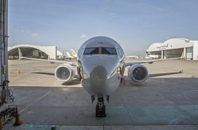 An Ethiopian Airlines Boeing 737 Max 8 sits grounded near a hangar at Bole International Airport in Addis Ababa, Ethiopia Saturday, March 23, 2019. The chief of Ethiopian Airlines says the warning and training requirements set for the now-grounded 737 Max aircraft may not have been enough following the Ethiopian Airlines plane crash that killed 157 people. (AP Photo/Mulugeta Ayene)