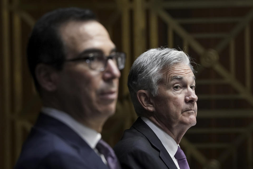 Treasury Secretary Steven Mnuchin, left, and Federal Reserve Board Chairman Jerome Powell testifies during a Senate Banking Committee hearing, Thursday Sept. 24, 2020 on Capitol Hill in Washington about the CARES Act and the economic effects of the coronavirus pandemic. (Drew Angerer/Pool via AP)