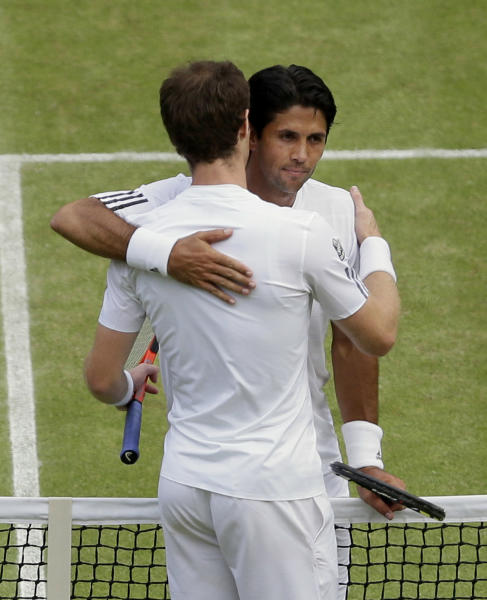 Andy Murray of Britain, front, embraces Fernando Verdasco of Spain after winning their Men's singles quarterfinal match at the All England Lawn Tennis Championships in Wimbledon, London, Wednesday, July 3, 2013. (AP Photo/Alastair Grant)