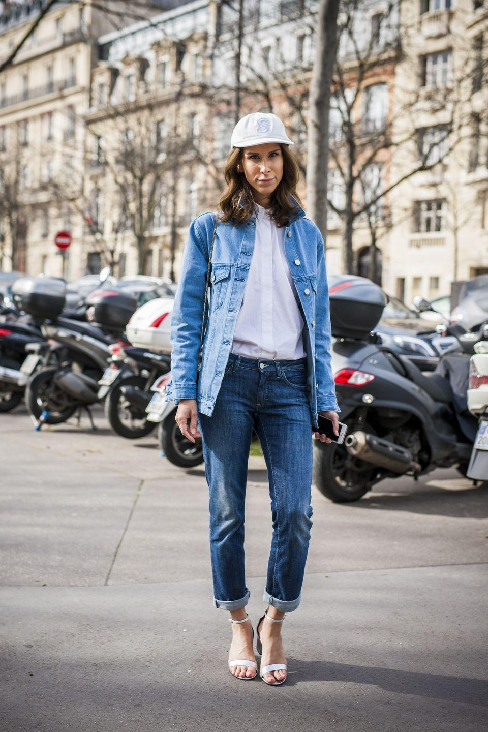 "<p>Don't listen to nay sayers. Denim on denim is a DO! The denim doesn't have to match necessarily, it's really more about proportions and keeping it simple with your accessories. The touch of a <a href=""https://www.amazon.com/slp/womens-white-button-up-shirt/oqj7c262v47c5ft?tag=syn-yahoo-20&ascsubtag=%5Bartid%7C10055.g.27890498%5Bsrc%7Cyahoo-us"" rel=""nofollow noopener"" target=""_blank"" data-ylk=""slk:crisp white button down"" class=""link rapid-noclick-resp"">crisp white button down</a>, baseball cap, and ankle strap heel keep things sophisticated and polished. </p>"
