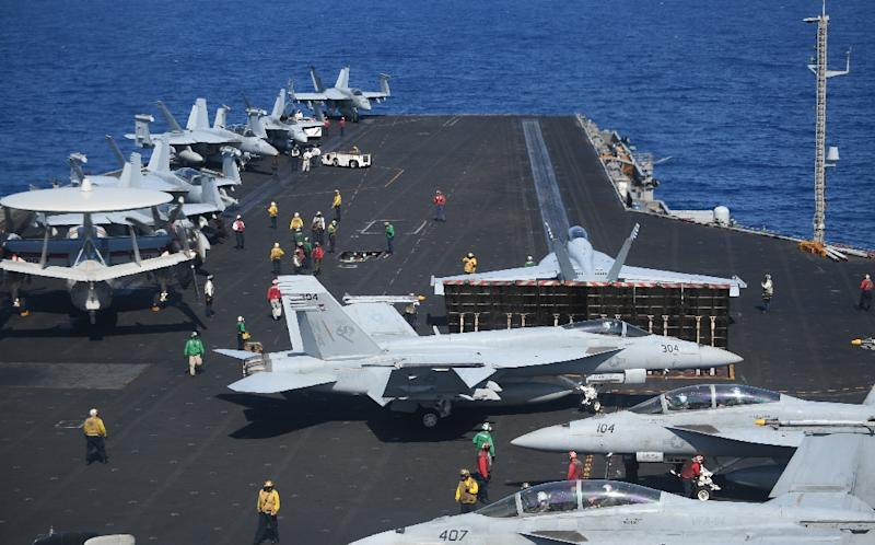 US warships regularly conduct 'freedom of navigation' operations near islands controlled by Beijing (AFP Photo/TED ALJIBE)