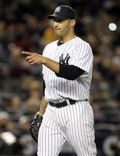 New York Yankees starting pitcher Andy Pettitte reacts after finishing the top of the sixth inning of a baseball game against the Tampa Bay Rays at Yankee Stadium in New York, Tuesday, June 5, 2012. (AP Photo/Seth Wenig)