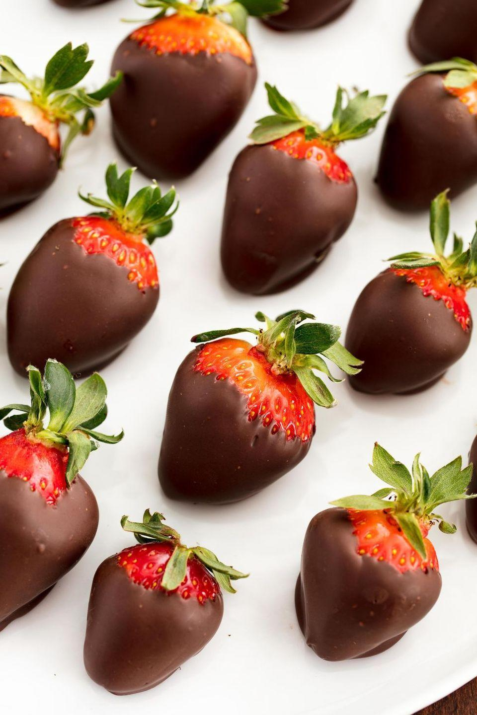 """<p>Is there anything better than <a href=""""https://www.delish.com/uk/cooking/recipes/a33257445/chocolate-covered-strawberry-cubes-recipe/"""" rel=""""nofollow noopener"""" target=""""_blank"""" data-ylk=""""slk:chocolate-covered strawberries"""" class=""""link rapid-noclick-resp"""">chocolate-covered strawberries</a>? We think not. They're at once indulgent and classy, romantic and a little cheesy.</p><p>Get the <a href=""""https://www.delish.com/uk/cooking/recipes/a33631827/how-to-make-chocolate-covered-strawberries/"""" rel=""""nofollow noopener"""" target=""""_blank"""" data-ylk=""""slk:Chocolate Covered Strawberries"""" class=""""link rapid-noclick-resp"""">Chocolate Covered Strawberries</a> recipe.</p>"""