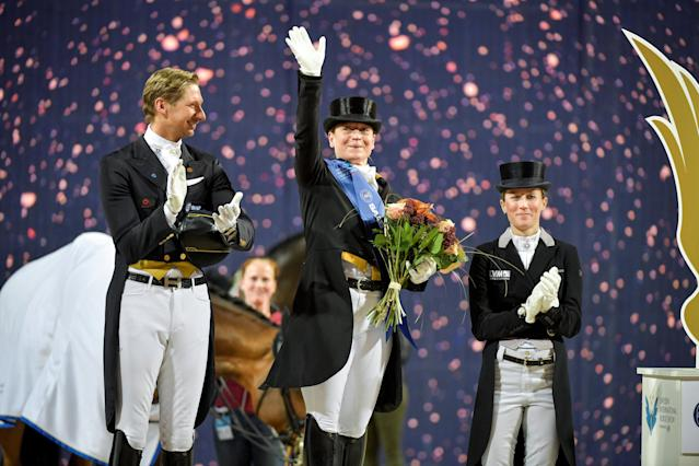 Equestrian - Sweden International Horse Show - FEI Grand Prix Freestyle to Music event - Friends Arena, Stockholm, Sweden - December 3, 2017 - (L-R) Second placed Patrik Kittel of Sweden, winner Isabell Werth of Germany and third placed Helen Langehanenberg of Germany are seen during the award ceremony . TT News Agency/Jessica Gow via REUTERS ATTENTION EDITORS - THIS IMAGE WAS PROVIDED BY A THIRD PARTY. SWEDEN OUT. NO COMMERCIAL OR EDITORIAL SALES IN SWEDEN