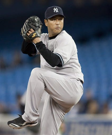 New York Yankees starting pitcher Hiroki Kuroda throws to a Toronto Blue Jays batter during the first inning of a baseball game in Toronto on Friday, Sept. 28, 2012. (AP Photo/The Canadian Press, Chris Young)