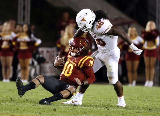 "<a class=""link rapid-noclick-resp"" href=""/ncaaf/players/252192/"" data-ylk=""slk:Malik Jefferson"">Malik Jefferson</a> had 110 tackles and four sacks in 2017, including this sack of Jacob Park. (Photo by David Purdy/Getty Images)"