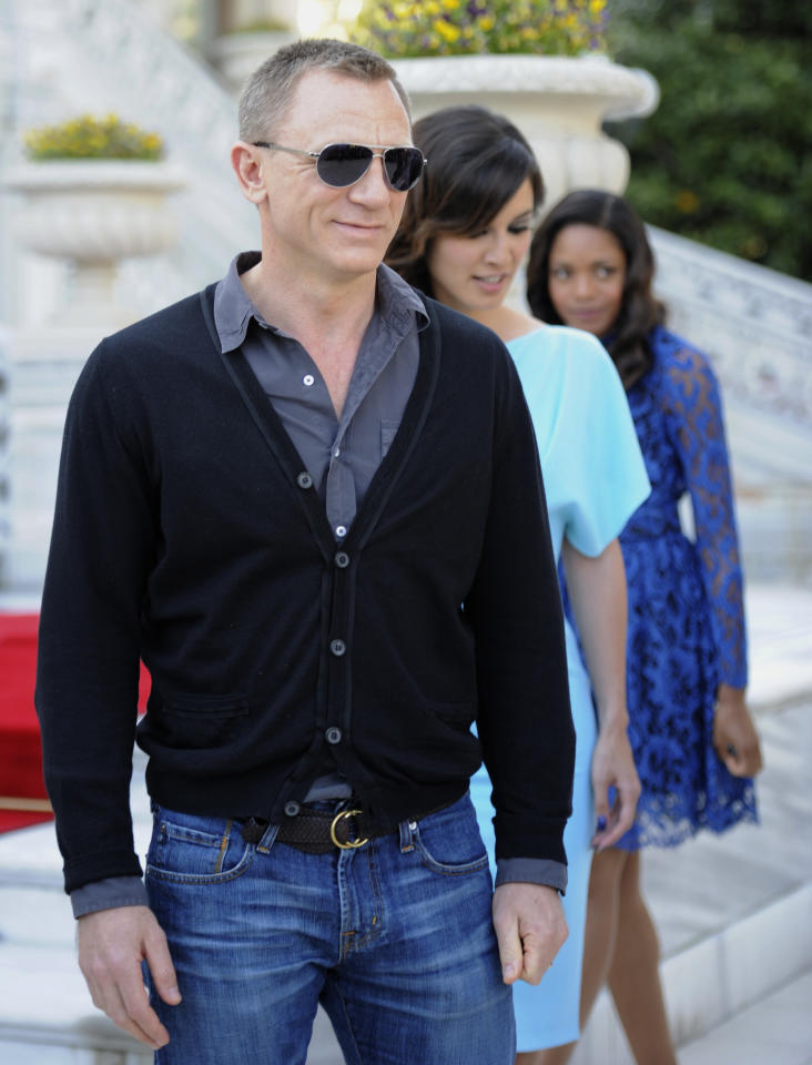 French actress Berenice Marlohe, center, British actor Daniel Craig and British actress Naomie Harris arrive for the photocall of the 23rd film in the James Bond series, 'Skyfall', in Istanbul, Turkey, Sunday, April 29, 2012.(AP Photo )