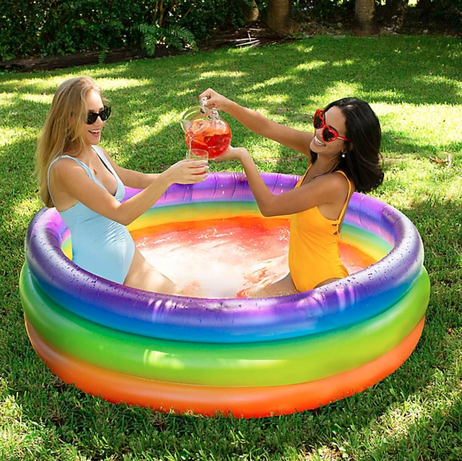 """<h2>Bed Bath & Beyond</h2><br>BB&B boasts an impressive lineup of blow-up pool styles in every size from """"petite-chic"""" to practical and family-sized. <br><br>Plus, if you see options that are out of stock online, you may still be able to order them for curbside pickup at your nearest store location — which is faster and more affordable than having it shipped anyways!<br><br><em>Shop inflatable pools at <strong><a href=""""https://www.bedbathandbeyond.com/store/s/inflatable-pools"""" rel=""""nofollow noopener"""" target=""""_blank"""" data-ylk=""""slk:Bed Bath & Beyond"""" class=""""link rapid-noclick-resp"""">Bed Bath & Beyond</a></strong></em><br><br><strong>Pool Candy</strong> Adult Inflatable Rainbow Sunning Pool, $, available at <a href=""""https://go.skimresources.com/?id=30283X879131&url=https%3A%2F%2Fwww.bedbathandbeyond.com%2Fstore%2Fproduct%2Fpool-candy-adult-inflatable-rainbow-sunning-pool%2F5523225"""" rel=""""nofollow noopener"""" target=""""_blank"""" data-ylk=""""slk:Bed Bath & Beyond"""" class=""""link rapid-noclick-resp"""">Bed Bath & Beyond</a>"""
