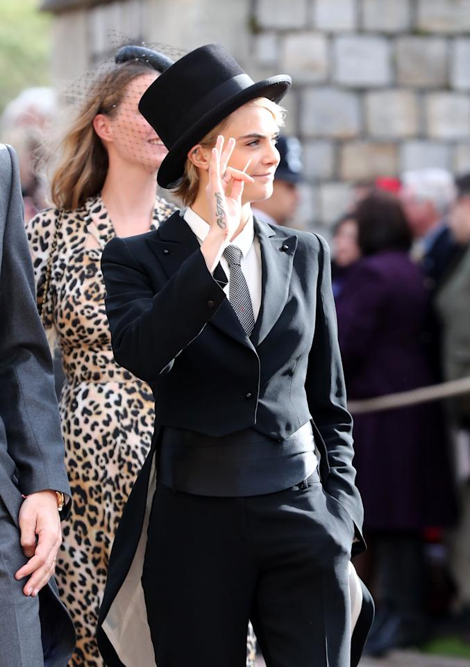 <p>When Cara Delevingne arrived in a top hat and tails putting a gender-bending twist on the royal dress code. Hey, it's 2018 after all! </p>