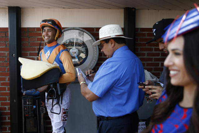 A jockey is weighed in the winner's circle following the day's seventh race at Pimlico Race Course, Saturday, May 18, 2019, ahead of the Preakness Stakes horse race in Baltimore. (AP Photo/Patrick Semansky)