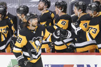 Pittsburgh Penguins' Jake Guentzel (59) is greeted by Cody Ceci (4) and other teammates on the bench after scoring against the New York Islanders during the second period of an NHL hockey game, Saturday, Feb. 20, 2021, in Pittsburgh. (AP Photo/Keith Srakocic)