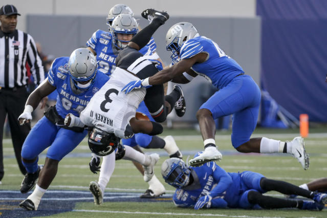 Cincinnati running back Michael Warren II (3) flips as he carries the ball against Memphis during the first half of an NCAA college football game for the American Athletic Conference championship Saturday, Dec. 7, 2019, in Memphis, Tenn. (AP Photo/Mark Humphrey)