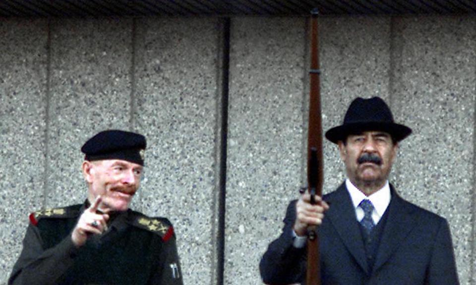 Izzat Ibrahim al-Douri attending a military parade with Saddam Hussein in 2000.