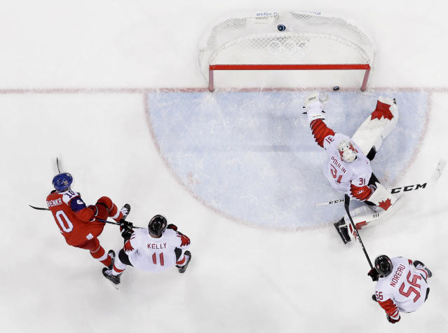 Roman Cervenka (10), of the Czech Republic, scores past goalie Kevin Poulin (31), of Canada, during the third period of the men's bronze medal hockey game at the 2018 Winter Olympics in Gangneung, South Korea, Saturday, Feb. 24, 2018. (AP Photo/Jae C. Hong)