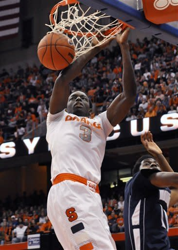 Syracuse's Jerami Grant dunks against Monmouth's Khalil Brown during the first half of an NCAA college basketball game in Syracuse, N.Y., Saturday, Dec. 8, 2012. (AP Photo/Kevin Rivoli)