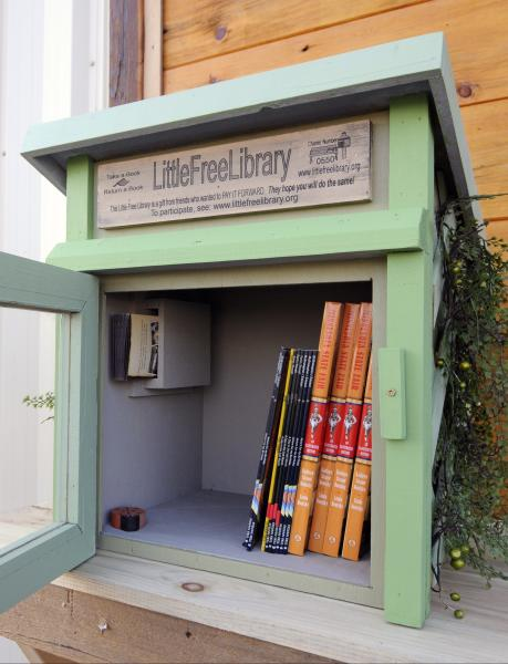 In this Thursday, Dec. 6, 2012 photo, one of the Little Free Libraries lending boxes is shown in Hudson, Wis. The non-profit Little Free Libraries movement is branching out in new directions including inner-city neighborhoods where kids might not have many books and into developing countries were people are hungry for reading material and by Christmas expects its followers will have erected over 5,000 book boxes across the U.S. alone. (AP Photo/Jim Mone)
