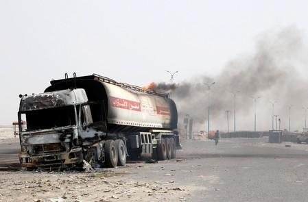 Smoke rises from an oil tanker truck set a blaze during clashes between southern separatist fighters and government forces in Aden